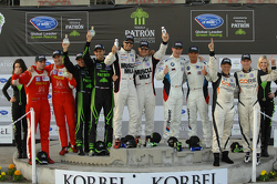 Overall podium: P1 winners Klaus Graf, Lucas Luhr, P2 winners Scott Sharp, Guy Cosmo, PC winners Jonathan Bennett, Colin Braun, GT winners Bill Auberlen, Maxime Martin, GTC winners Henrique Cisneros, Sean Edwards