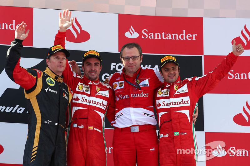 Podium: race winner Fernando Alonso, Ferrari, second place Kimi Raikkonen, Lotus F1, Third place Fel