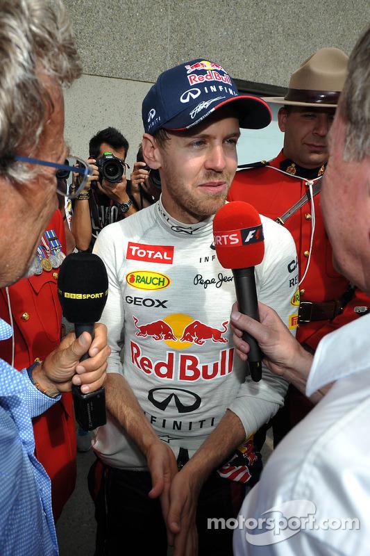 Race winner Sebastian Vettel, Red Bull Racing is interviewed by Eddie Jordan