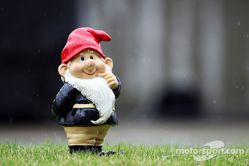 A gnome in the rain in the pit lane