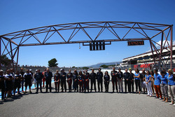 Teams and drivers have a moment of silence for Lamborghini Super Trofeo driver Andrea Mamé
