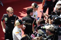 Kimi Raikkonen, Lotus F1 Team and Romain Grosjean, Lotus F1 Team with the media