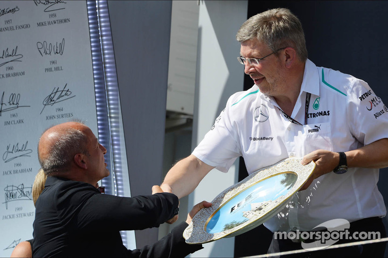 Ross Brawn, Mercedes AMG F1 Team Principal celebrates on the podium