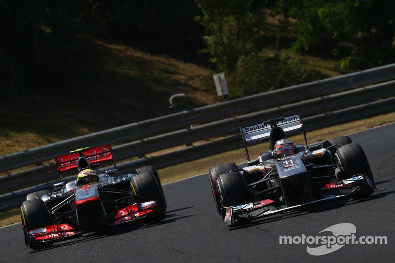 Sergio Perez, McLaren MP4-28 and Nico Hulkenberg, Sauber C32