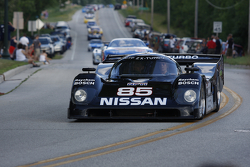 Race cars parade into Elkhart Lake for the Friday concours. #85 1990 Nissan NPT: George Krass