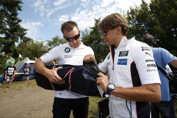 Joey Hand and Augusto Farfus build a tent