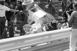 The shocking remains of the Hill GH1 of Rolf Stommelen, sit on the wrong side of the Armco following his massive accident