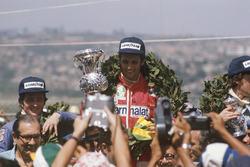 Podium: race winner Niki Lauda, Ferrari, Patrick Depailler, Tyrrell 007, third place Tom Pryce, Shadow