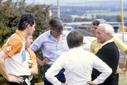Team owners and sponsors discuss the proposed drivers strike: Daniele Audetto, Alan Rees, Ken Tyrrell, Bernie Ecclestone, Peter Warr and Colin Chapman
