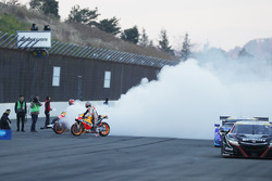 Marc Marquez, Dani Pedrosa, Repsol Honda Team perform burnouts with Honda NSX Super GT cars