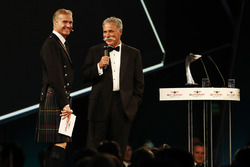 David Coulthard shares a joke on stage with Chase Carey, Chairman, Formula One