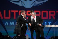 Lando Norris, George Russell and Derek Warwick on stage
