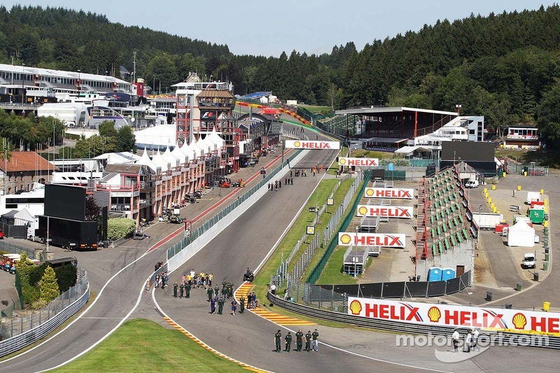 Drivers walk the circuit and approach Eau Rouge.