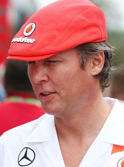 Sam Michael, McLaren Sporting Director wearing a cap celebrating 50 years of McLaren as a constructor