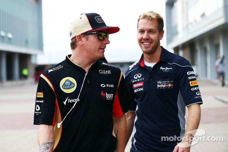 (L naar R): Kimi Raikkonen, Lotus F1 Team met Sebastian Vettel, Red Bull Racing