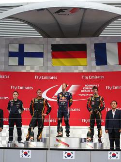 1st place Sebastian Vettel, Red Bull Racing, 2nd place Kimi Raikkonen, Lotus F1 Team and 3rd place Romain Grosjean, Lotus F1 E21