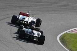 Jenson Button, McLaren MP4-28 leads Kimi Raikkonen, Lotus F1 E21