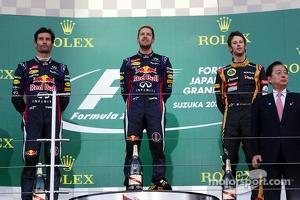 The podium: Mark Webber, Red Bull Racing, second; Sebastian Vettel, Red Bull Racing, race winner; Romain Grosjean, Lotus F1 Team, third