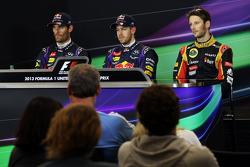 Qualifying top three in the FIA Press Conference: Mark Webber, Red Bull Racing, second; Sebastian Vettel, Red Bull Racing, pole position; Romain Grosjean, Lotus F1 Team, third.