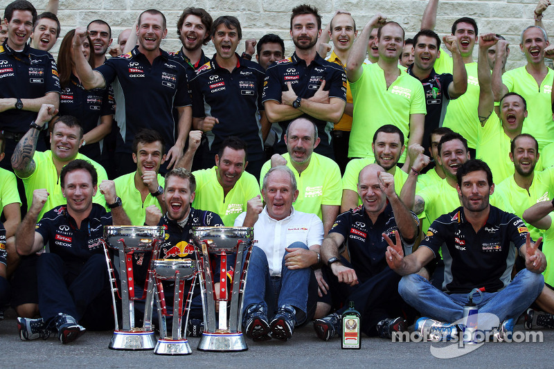 Race winner Sebastian Vettel, Red Bull Racing and third placed team mate Mark Webber, Red Bull Racing celebrate with the team