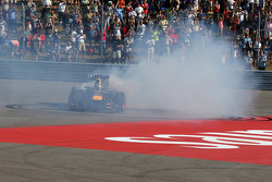 Race winner Sebastian Vettel, Red Bull Racing RB9 celebrates at the end of the race with some doughnuts