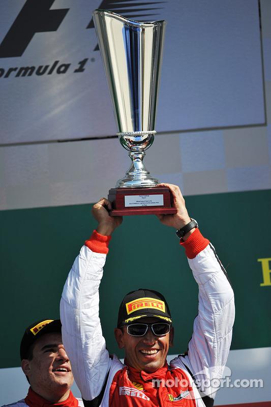 Podium: race winner Carlos Gomez