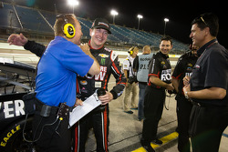 Kurt Busch, Furniture Row Racing Chevrolet shares a laugh with Dr. Jerry Punch