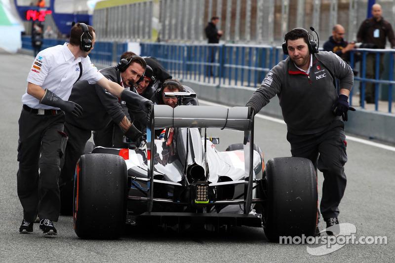 Esteban Gutierrez, Sauber C33 is pushed back down the pit lane