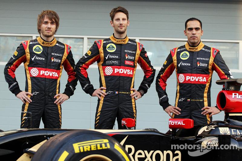 (L to R): Charles Pic, with Romain Grosjean, Lotus F1 Team and team mate Pastor Maldonado, Lotus F1