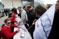 Tom Kristensen and Loic Duval sign autographs
