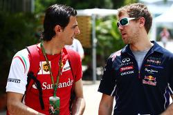 (L to R): Pedro De La Rosa, Ferrari Development Driver with Sebastian Vettel, Red Bull Racing