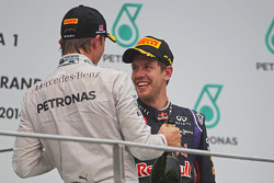 (L to R): Second placed Nico Rosberg, Mercedes AMG F1 on the podium with third placed Sebastian Vettel, Red Bull Racing