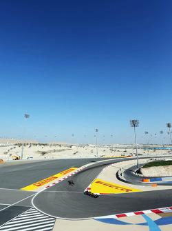 Pastor Maldonado, Lotus F1 E21 leads Sebastian Vettel, Red Bull Racing RB10