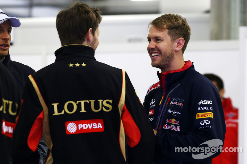 Romain Grosjean, Lotus F1 Team y Sebastian Vettel, Red Bull Racing en el desfile de pilotos