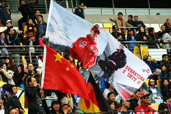 Flags for Michael Schumacher, and Sebastian Vettel, Red Bull Racing.