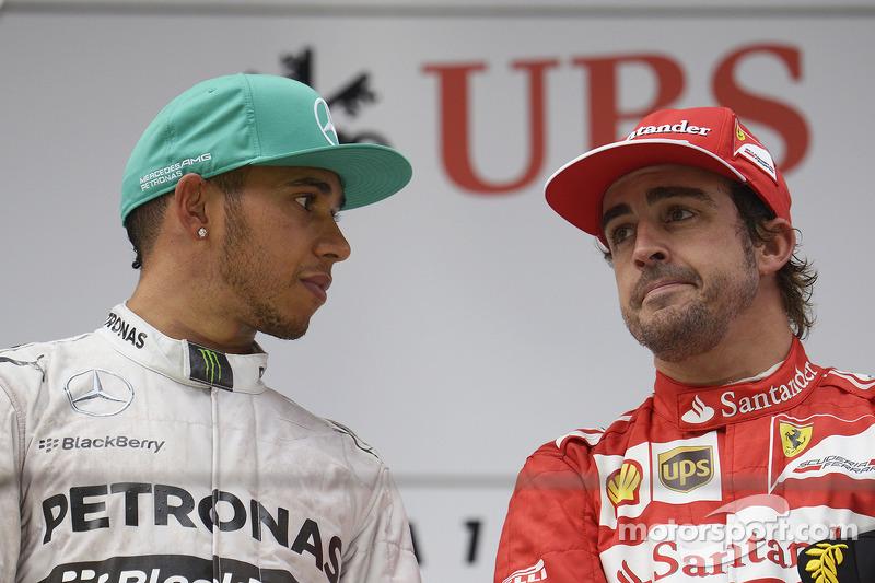 The podium Race winner Lewis Hamilton, Mercedes AMG F1 with Fernando Alonso, Ferrari