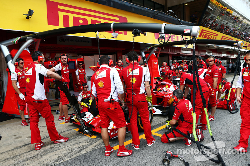Ferrari practice pit stops with a pit stop gantry