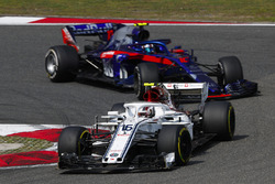 Charles Leclerc, Sauber C37 Ferrari, leads Pierre Gasly, Toro Rosso STR13 Honda