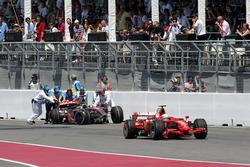 Felipe Massa, Ferrari F2008 passes the retired car of Lewis Hamilton, McLaren Mercedes MP4/23