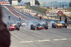Poleman Chris Amon, Ferrari 312 is left behind by Pedro Rodriguez, BRM P133 and Denny Hulme, McLaren M7A Ford at the start