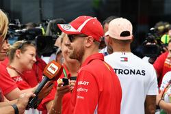 Sebastian Vettel, Ferrari and Lewis Hamilton, Mercedes-AMG F1