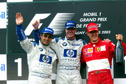 Podium: second place Juan Pablo Montoya, Williams, Race winner Ralf Schumacher, Williams, third place Michael Schumacher, Ferrari
