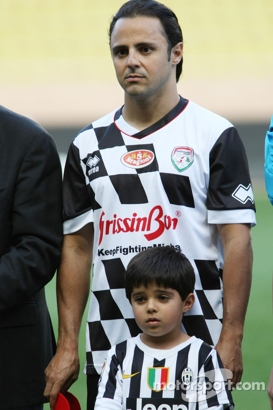Felipe Massa, Williams with his son Felipinho at the charity football match