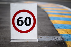 60-km/h limit sign at pit entrance