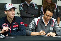 (L to R): Daniil Kvyat, Scuderia Toro Rosso and Esteban Gutierrez, Sauber sign autographs for the fans
