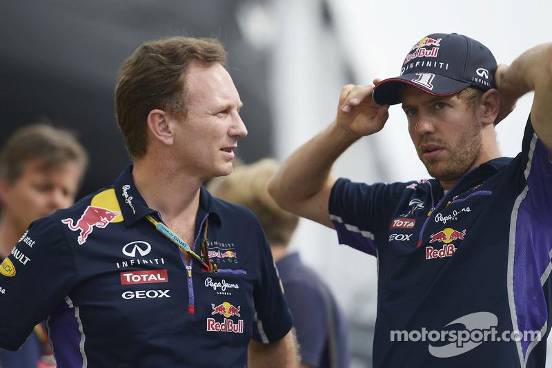 (L to R): Christian Horner, Red Bull Racing Team Principal with Sebastian Vettel, Red Bull Racing