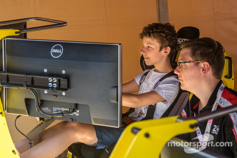 Fans enjoying the racing simulator at scrutineering