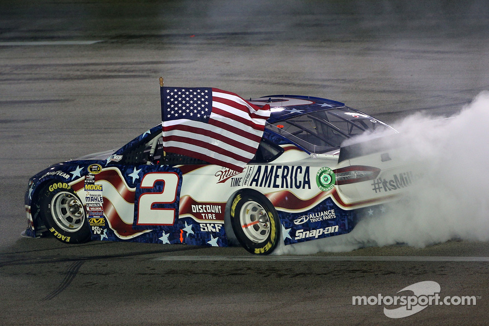 Brad Keselowski celebrates his win