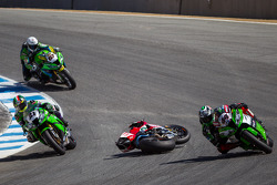 Riders dodge the bike of Davide Giugliano