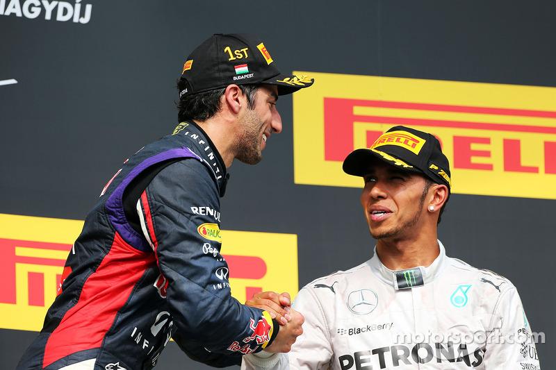 Daniel Ricciardo, Red Bull Racing celebrates on the podium with third placed Lewis Hamilton, Mercede